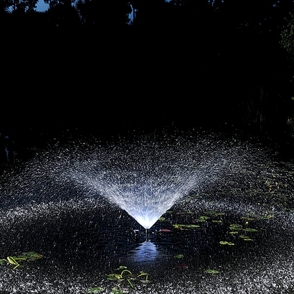 Pond Boss 1/2 HP Floating Fountain - Trumpet Fountain Nozzle at Night